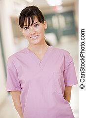 Nurse Standing In A Hospital Corridor