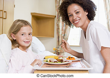 Nurse Feeding Young Girl