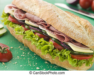 Deli Sub Sandwich on a Chopping Board