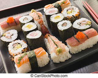 Selection of Seafood and Vegetable Sushi on a Tray with...