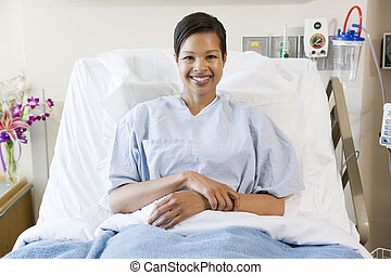 Woman Sitting In Hospital Bed