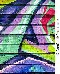 Brightly colored graffiti on wood slats - Bright graffiti...