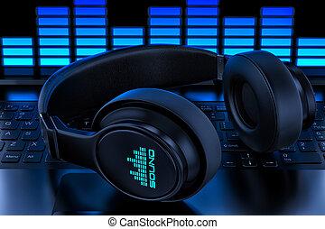 Headphones on laptop. Recording audio