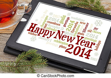 Happy New Year 2014 - word cloud on a digital tablet with a...