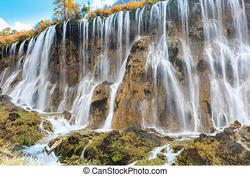 beautiful waterfall in autumn at jiuzhaigou valley national...