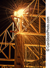 Welding steel structure with sparks - Welding with sparks in...