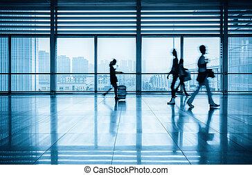 passengers motion blur in modern corridor - commuters motion...