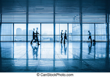 passengers motion blur in modern corridor - commuters motion...