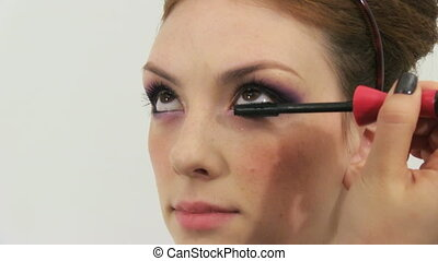 make up - Beauty woman having her made up by stylist
