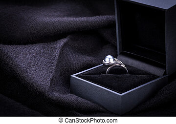 Diamond engagement ring in a box - Dark mysterious image of...