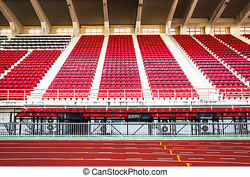 Stadium with red seats and red running track - White number...