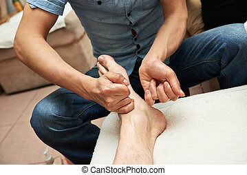 Foot massage - Masseur making a traditional chinese foot...