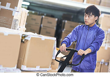chinese warehouse worker with forklift stacker - Male...