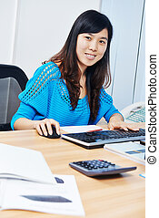 chinese office manager woman at work place