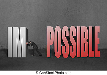 """Businessman push word """"impossible"""" im away, to make it..."""