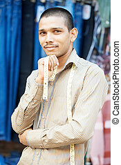 Young indian tailor man - Portrait of one Indian tailor...