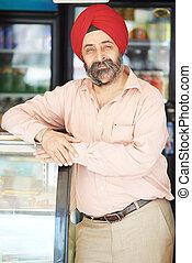 adult indian sikh seller man - Portrait of Indian sikh man...
