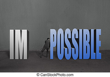 "Businessman push word ""impossible"" possible to separate, to..."