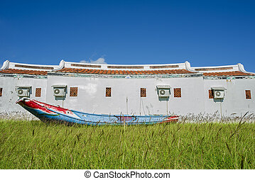 Traditional Asia building in Taiwan with wooden boat, meadow...