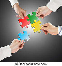 Team work concept, Hands hold puzzles connect each other...