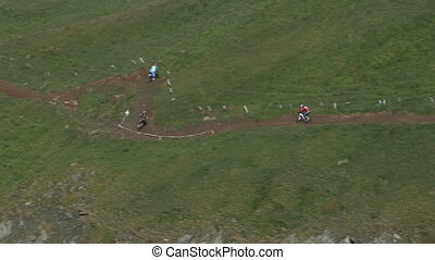 Cyclists going downhill - Aerial view of cyclist going...