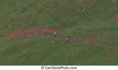 Cyclists going downhill - Aerial view of cyclists going...