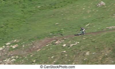 Cyclist going downhill - Aerial view of cyclist going...