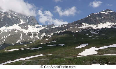 Snowy mountains and green hills