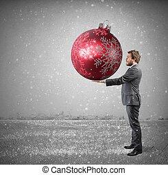Businessman with big Christmas ball