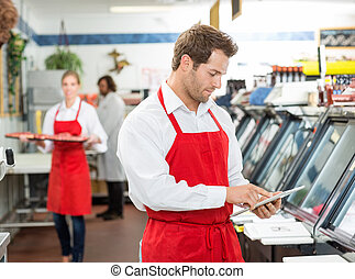 Confident Male Butcher Standing Arms Crossed At Store - Male...