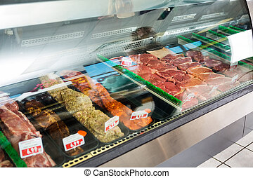 Meat Displayed In Butcher's Shop - Variety of meat displayed...