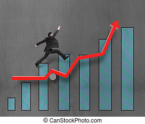 Businessman running and jumping on growth red arrow with...