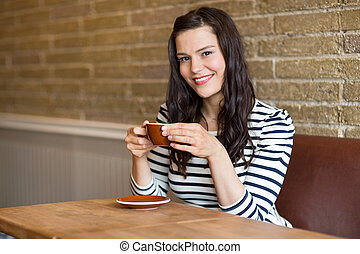 Woman in Coffee Shop Holding Cup - Portrait of attractive...