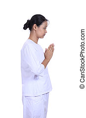 Beautiful woman standing in prayer position, meditating
