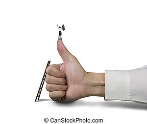Businessman standing on top of thumb with 2 hands up, white...