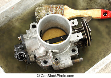 Cleaning carburetor with gasoline