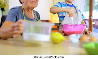 Having fun baking with my grandson - Elder woman having fun...