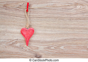 one hanging hearts - one red hearts hanging on rope on...