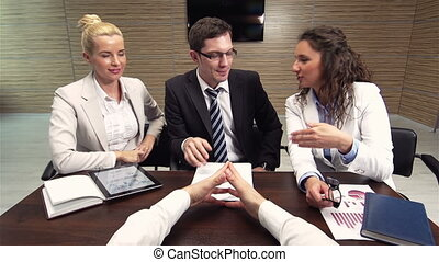 Contract For Client - Business team meeting their client to...