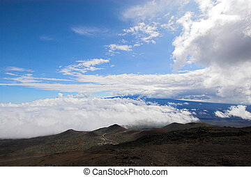 Barren landscape - Barren volcanic landscape and blue sky in...