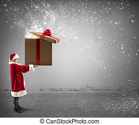 Litte Santa Claus holding a big Christmas present with magic...