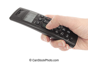 Womans hand holding a cordless telephone - Close up of a...