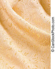 Gold damask with a shiny floral pattern - Soft folds of...
