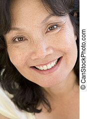 Head shot of woman smiling