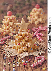Christmas tree cakes on a wooden table