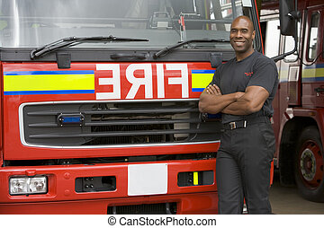 Fireman standing in front of fire engine