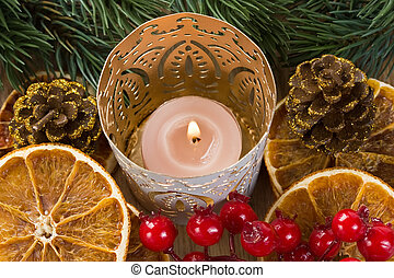 Christmas candle, dried orange slices and pine branch for...