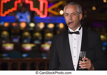 Man in casino with cigar and champagne (selective focus)