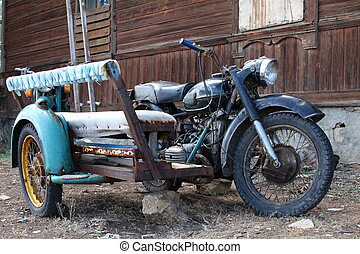 Vintage Sidecar - old heavy motorcycle with sidecar