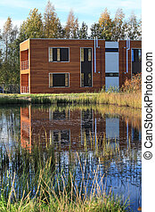 modern building - modern wooden residential building on the...
